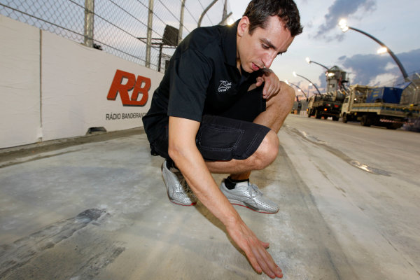 13-14 March, 2010, Sao Paolo, BrazilJustin Wilson inspects the results of the pavement grinding©2010, Michael L. Levitt, USALAT Photographic
