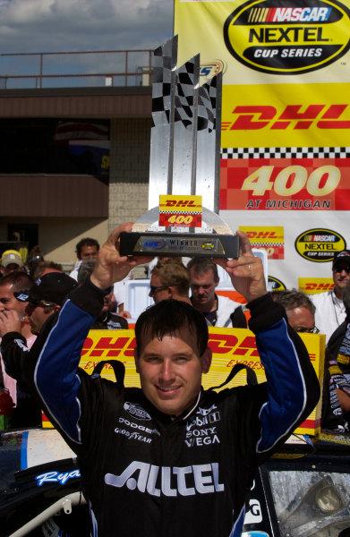 18-20 June, 2004, Michigan International Speedway, USA,Ryan Newman with trophy overhead,Copyright-Robt LeSieur 2004 USALAT Photographic