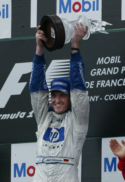 2003 French Grand Prix - Sunday Race,Magny Cours, France. 06th July 2003 Race winner Ralf Schumacher, BMW Williams FW25, podium.World Copyright: Steve Etherington/LAT Photographic ref: Digital Image Only