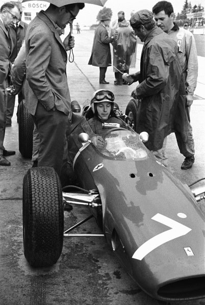 1964 German Grand Prix.  Nurburgring, Germany. 31st July - 02nd August 1964. John Surtees (Ferrari 158), 1st position, in the pits, portrait.  World Copyright: LAT Photographic.  Ref:  11098C - 12.