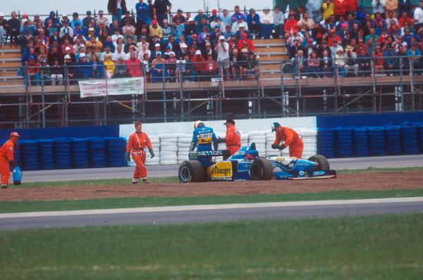 Silverstone, England.14-16 July 1995.Michael Schumacher (Benetton B195 Renault) walks away after having a collision with Hill on lap 46.Ref-95 GB 02.World Copyright - LAT Photographic