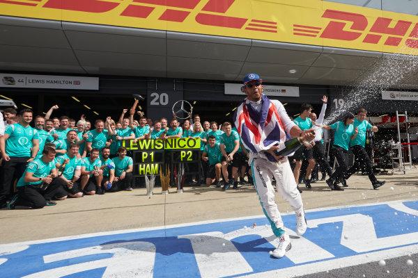 Silverstone, Northamptonshire, UK Sunday 10 July 2016. Lewis Hamilton, Mercedes AMG, 1st Position, and the Mercedes team celebrate victory. World Copyright: Steve Etherington/LAT Photographic ref: Digital Image SNE13411