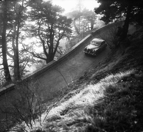 1956 Monte Carlo Rally. Ronnie Adams, Frank Biggar and Derek Johnston, Jaguar Mk7, 1st position, action.  World Copyright: LAT Photographic.  Ref:  Autocar Glass Plate C45422.