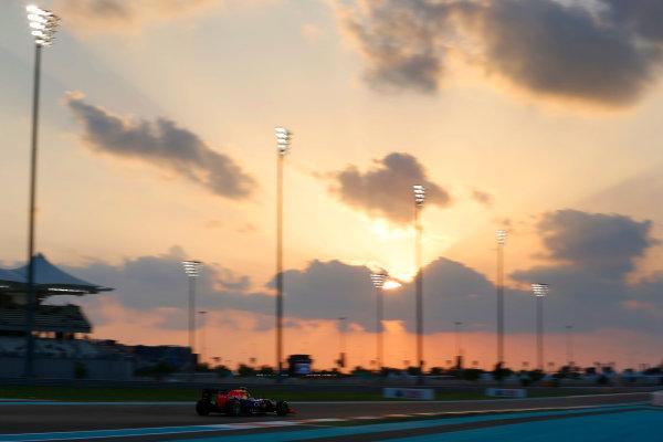 Yas Marina Circuit, Abu Dhabi, United Arab Emirates. Friday 27 November 2015. Daniil Kvyat, Red Bull Racing RB11 Renault. World Copyright: Charles Coates/LAT Photographic ref: Digital Image _99O6956