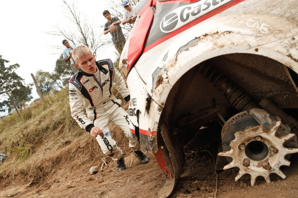 Ott Tanak (EST) examines the damage to his Ford Fiesta R5 after crashing out of the rally. FIA World Rally Championship, Rd5, Rally Argentina, Day Three, Cordoba-Villa Carlos Paz, Argentina, 11 May 2014.