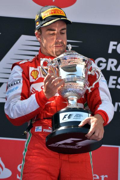 Race winner Fernando Alonso (ESP) Ferrari with his trophy on the podium. Formula One World Championship, Rd5, Spanish Grand Prix, Race Day, Barcelona, Spain, Sunday 12 May 2013.   BEST IMAGE