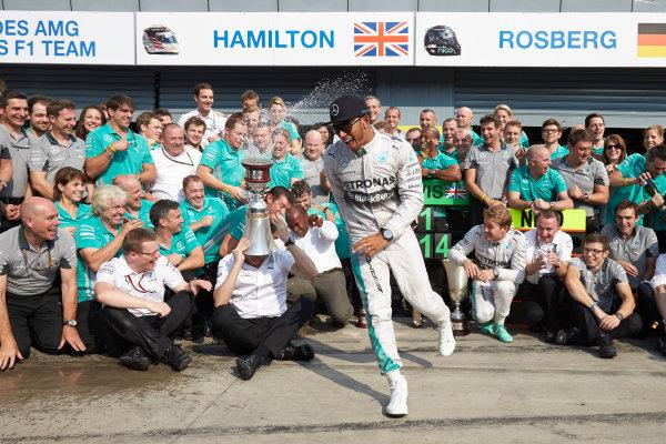 Autodromo Nazionale di Monza, Monza, Italy. Sunday 7 September 2014. Lewis Hamilton, Mercedes AMG, 1st Position, and the Mercedes AMG team celebrate. World Copyright: Steve Etherington/LAT Photographic. ref: Digital Image SNE15875