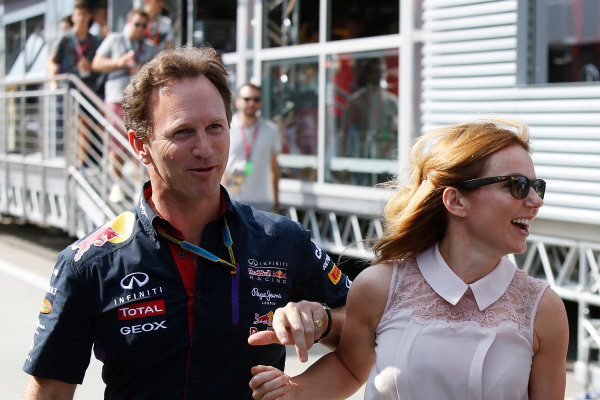 Hungaroring, Budapest, Hungary. Saturday 26 July 2014. Christian Horner, Team Principal, Red Bull Racing, with Geri Halliwell. World Copyright: Charles Coates/LAT Photographic. ref: Digital Image _J5R8119