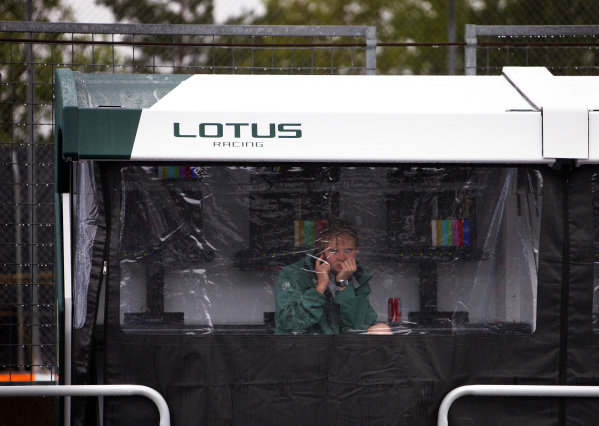 Circuit Gilles Villeneuve, Montreal, Canada10th June 2010A Lotus Racing team member shelters from the rain under a pit wall gantry cover.World Copyright: Steve Etherington/LAT Photographicref: Digital Image SNE24241