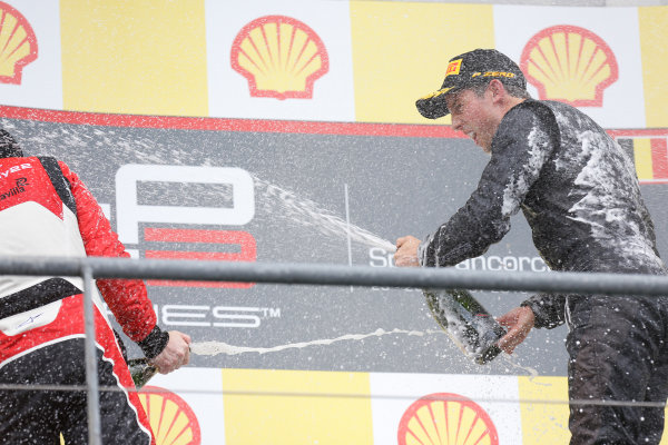 2013 GP3 Series. Round 6.  Spa - Francorchamps, Spa, Belgium. 25th August. Sunday Race. Alexander Sims (GBR, Carlin) celebrates his victory on the podium.  World Copyright: Alastair Staley/GP3 Media Service. ref: Digital Image _R6T8344.jpg