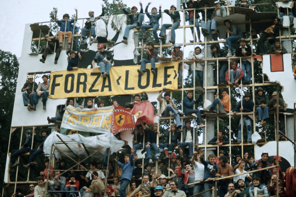 Monza, Italy. 10th - 12th September 1976. The Tifosi take to whatever means possible to get a decent view of the Ferrari cars, atmosphere. World Copyright: LAT Photographic. Ref: 76 ITA 12.