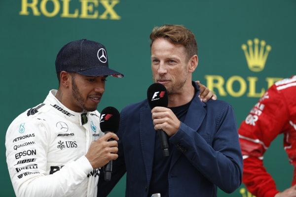 Silverstone, Northamptonshire, UK.  Sunday 16 July 2017. Lewis Hamilton, Mercedes AMG, 1st Position, is interviewed by Jenson Button, McLaren, on the podium. World Copyright: Glenn Dunbar/LAT Images  ref: Digital Image _X4I8342