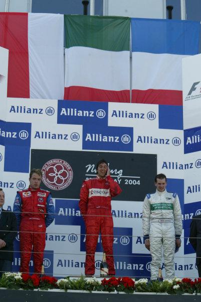 2004 Formula 3000 Championship (F3000) Nurburgring, Germany.29th May 2004. Winner Enrico Toccacelo (BCN F3000) celebrates on the podium wth Robert Doornbos (Arden International) and Yannick Schroeder (Durango Formula).World Copyright: LAT Photographic ref: Digital Image Only