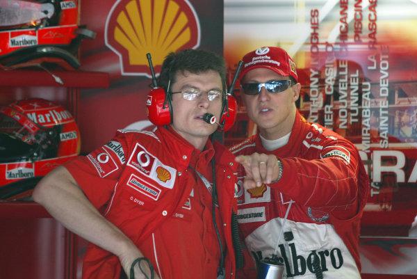 2004 Monaco Grand Prix - Thursday Practice,Monaco. 20th May 2004 Michael Schumacher, Ferrari F2004, with his race engineer Chris Dyer. Portrait.World Copyright: Steve Etherington/LAT Photographic ref: Digital Image Only