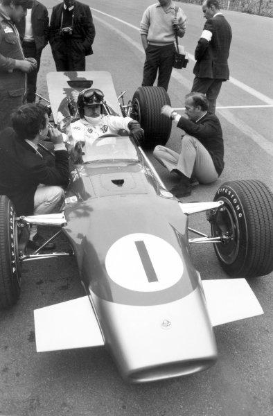 1968 Belgian Grand Prix.Spa-Francorchamps, Belgium. 9 June 1968.Graham Hill, Lotus 49B-Ford, retired, in the pitlane, portrait, helmet.World Copyright: LAT PhotographicRef: Motor b&w print