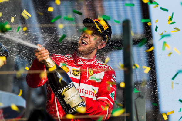 Albert Park, Melbourne, Australia. Sunday 26 March 2017. Sebastian Vettel, Ferrari, 1st Position, sprays Champagne on the podium. World Copyright: Zak Mauger/LAT Images ref: Digital Image _94I2379