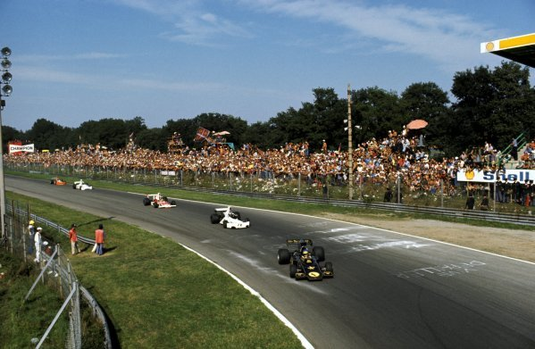 Race winner Ronnie Peterson (SWE) Lotus 72E leads Carlos Pace (BRA) Brabham BT44, who finished fifth, and Emerson Fittipaldi (BRA) McLaren M23, who finished second, into the Parabolica. Italian Grand Prix, Monza, 8 September 1974. BEST IMAGE