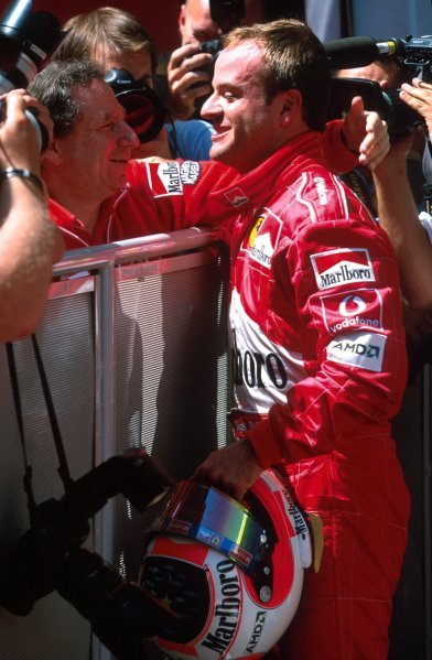 (L-R) Ferrari Team Manager Jean Todt (FRA) thanks Rubens Barrichello (BRA) for following team orders and making the team a point of ridicule. Formula One World Championship, Rd6, Austrian Grand Prix, A1-Ring, Austria. 12 May 2002. BEST IMAGE