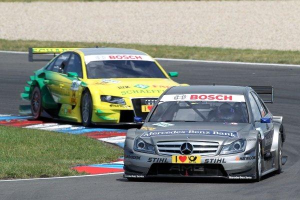 Bruno Spengler (CDN), Mercedes-Benz Bank AMG ahead of eventual race winner Martin Tomczyk (GER), Audi Sport Team Phoenix.DTM, Rd4, Eurospeedway Lausitz, Germany, 18-19 June 2011.