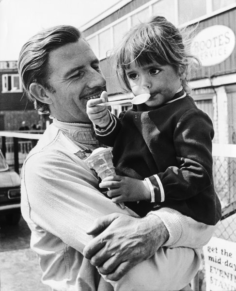 Silverstone, England. 25th April 1968.Graham Hill (Lotus 49-Cosworth), retired, with his 3 year old daughter Samantha, portrait. World Copyright: David Hudson/LAT Photographic.Ref:  DH - 68INT - Neg14A-15