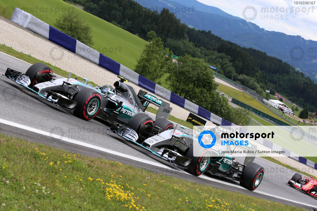 Nico Rosberg (GER) Mercedes AMG F1 W06 and Lewis Hamilton (GBR) Mercedes AMG F1 W06 at the start of the race at Formula One World Championship, Rd8, Austrian Grand Prix, Race, Spielberg, Austria, Sunday 21 June 2015.