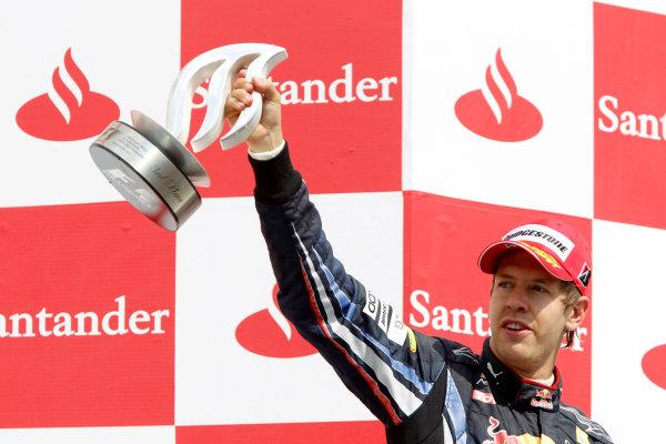 Hockenheimring, Hockenheim, Germany 25th July 2010 Sebastian Vettel, Red Bull Racing RB6 Renault, 3rd position, with his trophy on the podium. Portrait.  World Copyright: Glenn Dunbar/LAT Photographic ref: Digital Image _G7C2556