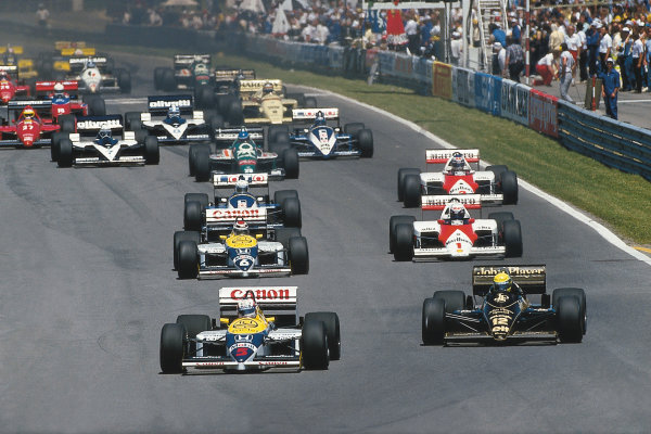 Montreal, Quebec, Canada.13-15 June 1986.Nigel Mansell (Williams FW11-Honda) leads Ayrton Senna (Lotus 98T-Renault) at the start. Mansell finished in 1st position.Ref-86 CAN 01.Please Note: This image is available as a 30mb+ CMYK Tiff scan upon request.World Copyright - LAT Photographic