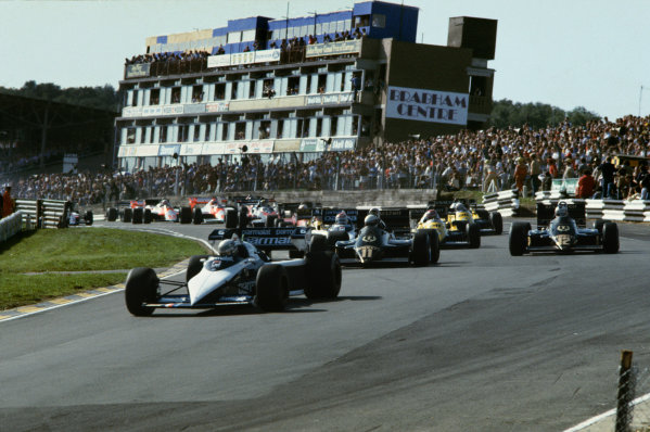 Brands Hatch, England.23-25 September 1983.Riccardo Patrese (Brabham BT52B BMW) leads Elio de Angelis (Lotus 94T Renault), Nelson Piquet (Brabham BT52B BMW) and Nigel Mansell (Lotus 94T Renault) through Paddock Hill Bend at the start. 