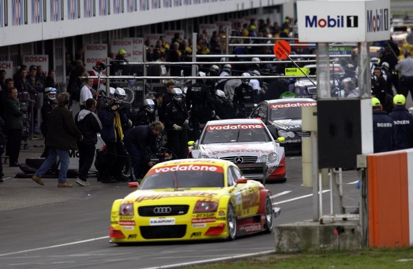 2002 DTM Championship.Hockenheim, Germany. 5-6 October 2002.Laurent Aiello (Abt Audi TT-R) exits the pit lane as Bernd Schneider (HWA/Mercedes CLK DTM) just finishes his pitstop.World Copyright - Andre Irlmeier/LAT Photographic