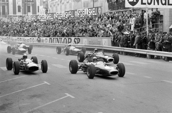 Jack Brabham, Brabham BT11 Climax, leads Lorenzo Bandini, Ferrari 1512, and Jackie Stewart, BRM P261, at the start.