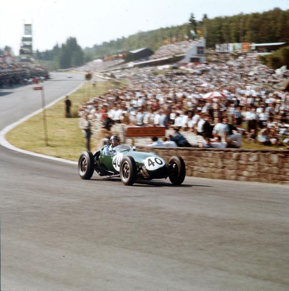 Spa-Francorchamps, Belgium.13-15 June 1958.Cliff Allison (Lotus 12-Climax) at Eau Rouge.Ref-3/0053.World Copyright - LAT Photographic