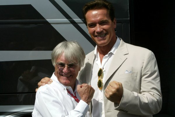 (L to R): Bernie Ecclestone (GBR) F1 Supremo with Arnold Schwarzenegger (AUT) Hollywood Movie Star. Formula One World Championship, Rd11, British Grand Prix, Race Day, Silverstone, England, 20 July 2003. DIGITAL IMAGE