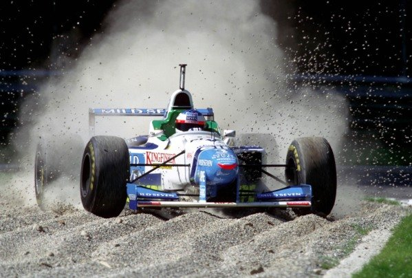 Jean Alesi, Benetton B196 Renault, takes a trip through the gravel.