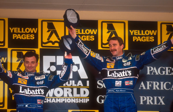 1992 South African Grand Prix.Kyalami, South Africa.28/2-1/3 1992.Nigel Mansell, 1st position with teammate Riccardo Patrese, 2nd position (both Williams Renault) on the podium.Ref-92 SA 06.World Copyright - LAT Photographic