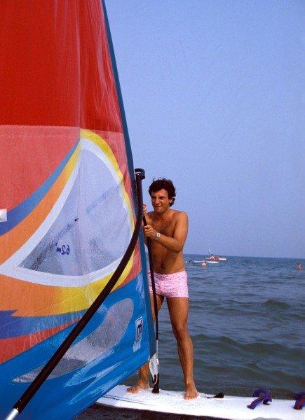 Venice, Italy. 1983. Riccardo Patrese enjoys himself windsurfing