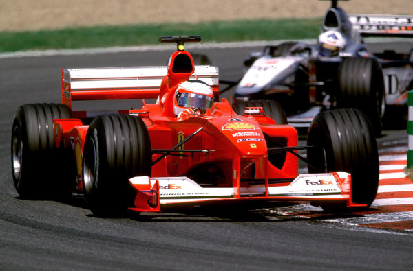 French Grand Prix.Magny-Cours, France. 30/6-2/7 2000.Michael Schumacher (Ferrari F1-2000) followed by David Coulthard (McLaren MP4/15 Mercedes).World Copyright - LAT PhotographicFormat: 35mm transparency
