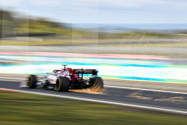Kimi Raikkonen, Alfa Romeo Racing C39, kicks up some sparks