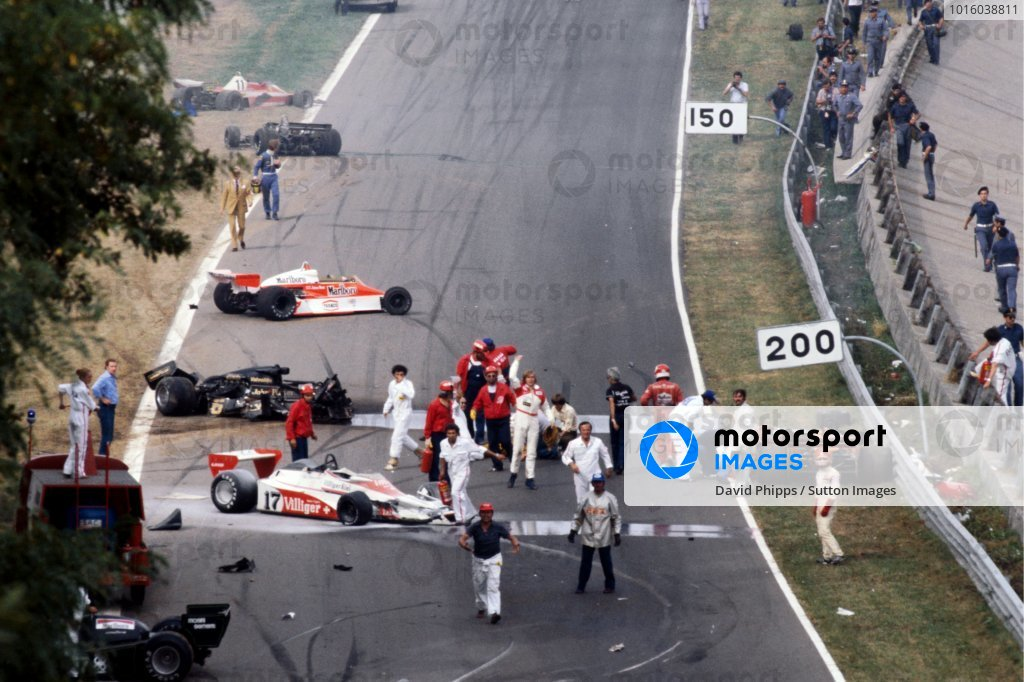 The immediate aftermath of the multi-car accident at the start of the race: Ronnie Peterson (SWE) Lotus (Yellow overalls) lies in the track having been pulled from his shattered, burning, Lotus 78, and is tended to by marshals. James Hunt (GBR) McLaren (Black helmet, white overalls) beckons for urgent help for Peterson. Clay Regazzoni (SUI) Ensign (Red Overalls) and marshalls attend the stricken Vittorio Brambilla (ITA) (Right), who is beside his Surtees TS20 after suffering a serious head injury from which he fully recovered. Bruno Giacomelli (ITA) (Below Orange Surtees TS20) looks back at the accident scene and Derek Daly (IRE) Ensign (Blue overalls top of picture) walks from his car. Tragically, Peterson would die from a blood clot following an operation in hospital on his badly broken legs. Italian Grand Prix, Rd 14, Monza, Italy, 10 September 1978. BEST IMAGE