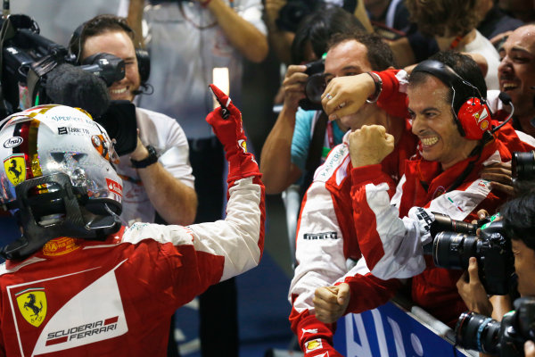 Marina Bay Circuit, Singapore. Sunday 20 September 2015. Sebastian Vettel, Ferrari, 1st Position, celebrates in Parc Ferme with his team. World Copyright: Alastair Staley/LAT Photographic. ref: Digital Image _79P3854