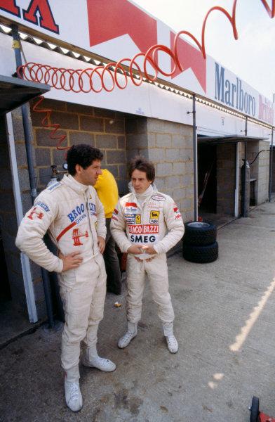 Silverstone, England. 12th - 14th July 1979. Jody Scheckter with team mate Ferrari Gilles Villeneuve. Ref-35mm 79 GB 08. World Copyright - LAT Photographic.