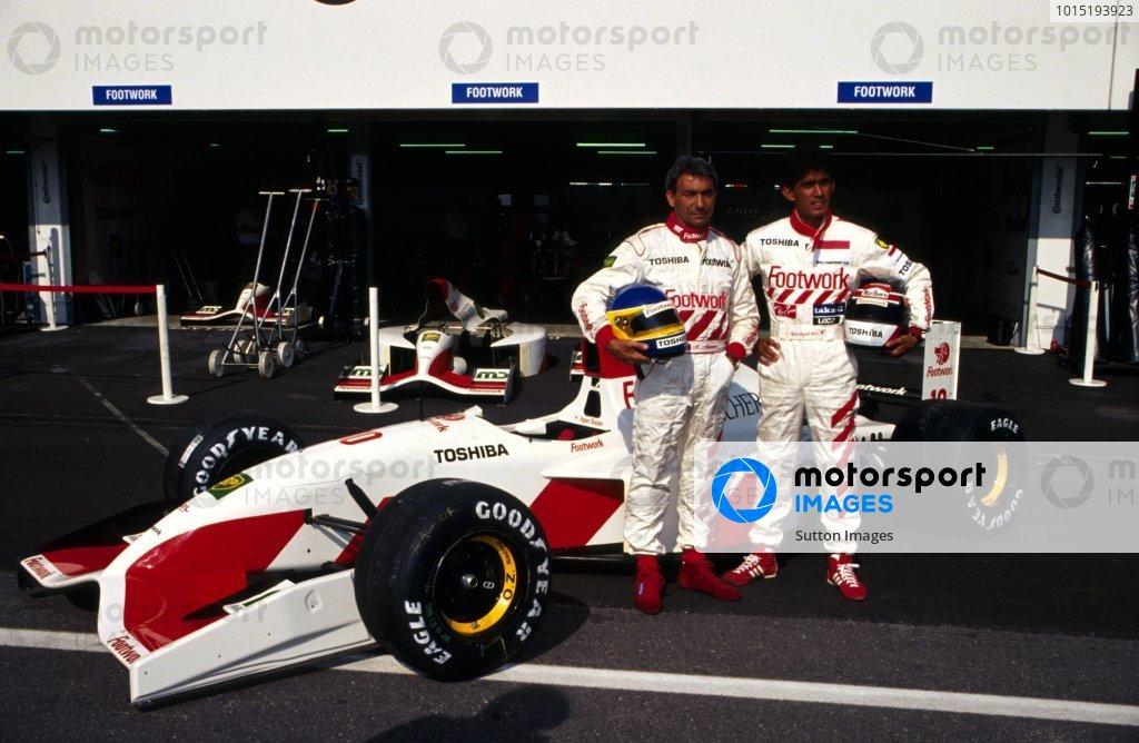 L-R: Michele Alboreto (ITA) Footwork with teammate Aguri Suzuki (JPN) and the Footwork Mugen-Honda FA13.German Grand Prix, Hockenheim, Germany, 26 July 1992.DIGITAL IMAGE
