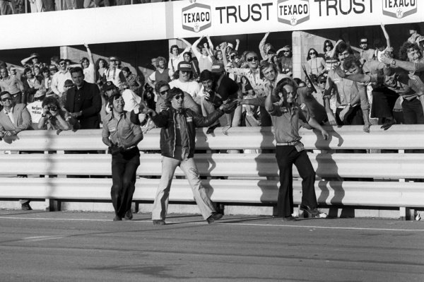 The Brabham team celebrate at the end of the race as winner Carlos Reutemann (ARG) and his team mate Carlos Pace (BRA) secure a 1-2 finish for the team.