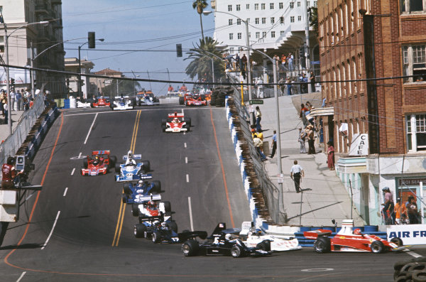 1976 Long Beach Grand Prix  Long Beach, California, USA. 26-28th March 1976.  The cars drop down Linden Avenue early in the race. Lauda heads Peterson, Pryce, Jarier, Watson, Scheckter, Laffite, Pace, Mass, Reutemann, Andretti, Fittipaldi and Amon.  Ref: 76LB17. World Copyright: LAT Photographic