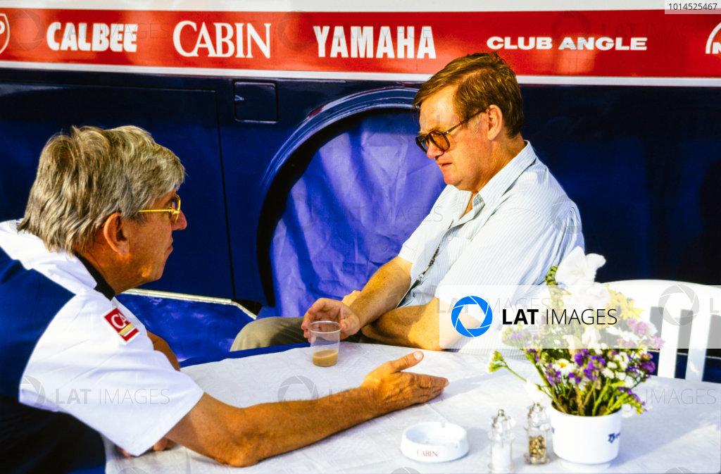 1993 Formula 1 World Championship. Tyrrell team boss, Ken Tyrrell talks with journalist, Alan Henry in the Tyrrell hospitality unit, portrait.  World Copyright: LAT Photographic.