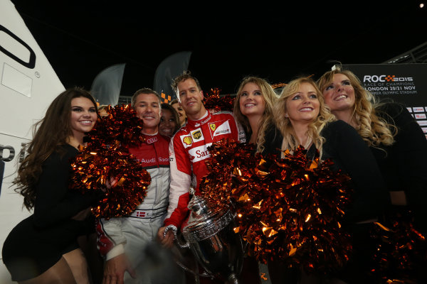 2015 Race Of Champions Olympic Stadium, London, UK Saturday 21 November 2015 Sebastian Vettel (GER) celebrates winning the Race of Champions with the cheerleaders Copyright Free FOR EDITORIAL USE ONLY. Mandatory Credit: 'IMP'