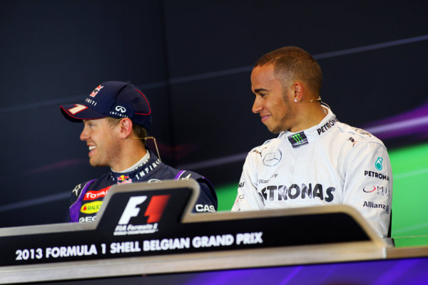 Spa-Francorchamps, Spa, Belgium. 24th August 2013. Front row starters Lewis Hamilton, Mercedes AMG, and Sebastian Vettel, Red Bull Racing, in the Press Conference. World Copyright: Sam Bloxham/LAT Photographic. ref: Digital Image IMG_8046.