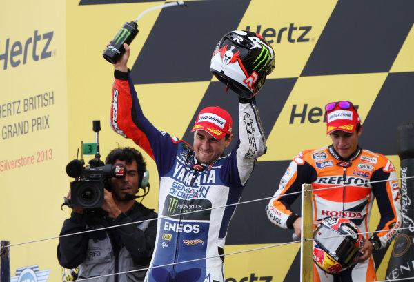 British Grand Prix.  Silverstone, England. 30th August - 1st September 2013.  Jorge Lorenzo, Yamaha, celebrates on the podium.  Ref: IMG_2462a. World copyright: Kevin Wood/LAT Photographic