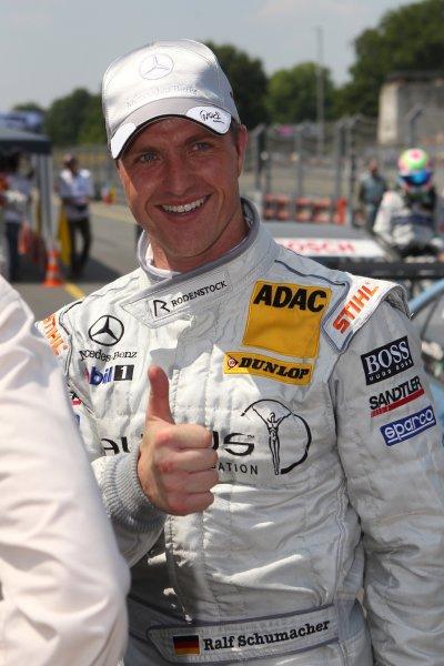 Ralf Schumacher (GER), Laureus AMG Mercedes, celebrates pole position.DTM, Rd4, Norisring, Nuremberg, Germany. 2-4 July 2010 World Copyright: LAT PhotographicRef: Digital Image dne1003jy73