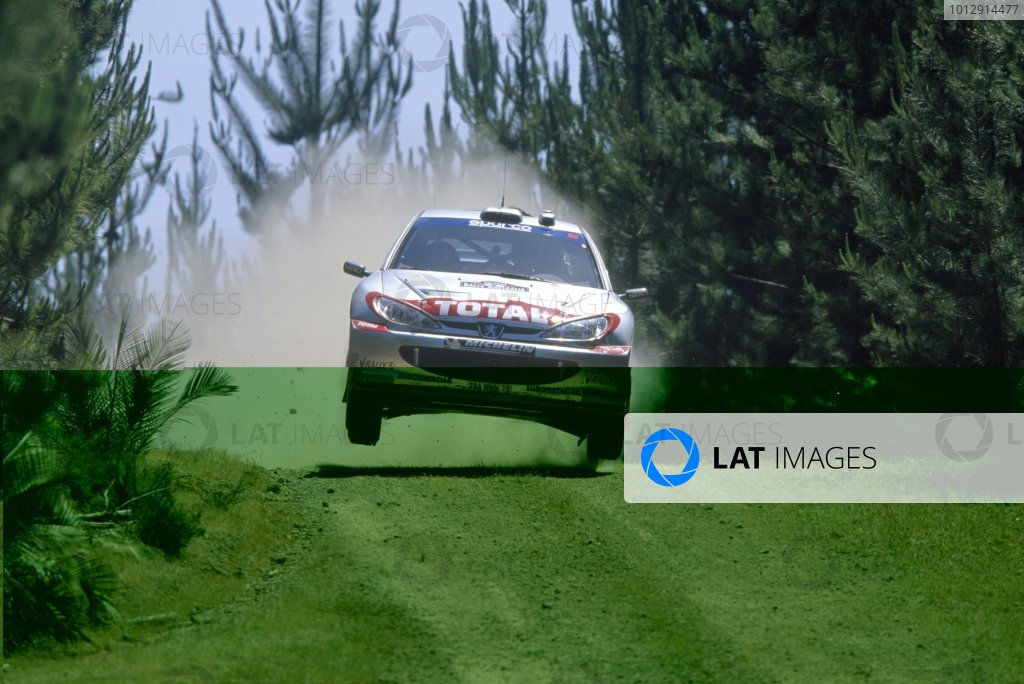 2002 World Rally Championship.Australian Rally, Australia. 10-13 November 2002.Marcus Gronholm/Timo Rautiainen (Peugeot 206 WRC), 1st position.World Copyright: McKlein/LAT PhotographicRef: 35mm transparency 02RALLY13