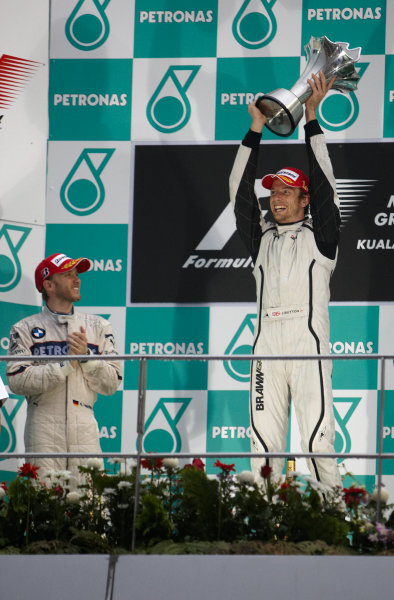 Sepang, Kuala Lumpur, Malaysia 5th April 2009 Jenson Button, Brawn GP BGP001 Mercedes, 1st position, and Nick Heidfeld, BMW Sauber F1.09, 2nd position, on the podium. Portrait. Podium.  World Copyright: Steve Etherington/LAT Photographic ref: Digital Image SNE15045